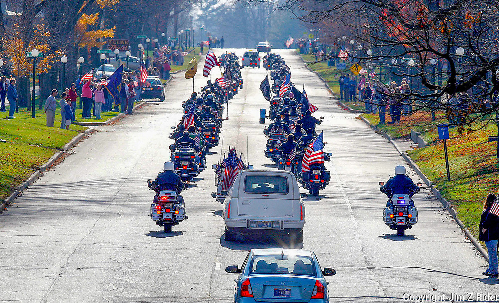The funeral procession of Staff Sgt. Justin DeCrow makes its way through downtown Plymouth, Indiana, Saturday November 14, 2009 on the way to Plymouth Wesleyan Church for his funeral service.  Staff Sgt. DeCrow was killed during last week's massacre at Fort Hood, Texas.  Patriotic songs from loud speakers filled the air as the procession passed through the small Northern Indiana town Sgt. DeCrow called home.