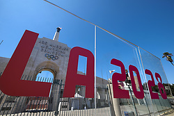 An LA2028 sign is seen in front of a blazing Olympic cauldron at the Los Angeles Memorial Coliseum on Wednesday, Sept. 13, 2017 in Los Angeles, the United States. The cauldron was lit early Wednesday morning at the stadium that was the site of the 1932 and 1984 Olympics. An International Olympic Committee meeting in Peru is to make it official that Los Angeles will host in 2028 and that the 2024 Games will go to Paris. (Credit Image: © Zhao Hanrong/Xinhua via ZUMA Wire)