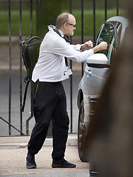 © Licensed to London News Pictures. 29/06/2020. London, UK. Senior government advisor Dominic Cummings jokingly punches the windows of his car as he arrives in Downing Street. Cabinet Secretary Sir Mark Sedwill has announced that he will stand down in September. Photo credit: Peter Macdiarmid/LNP