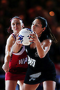 Joline Henry of New Zealand competes against Jade Clarke of England during the Netball semi final match. Glasgow 2014 Commonwealth Games. Netball, semi final Silver Ferns v England, Scottish Exhibition Conference Centre, Glasgow, Scotland. Saturday 2 August 2014. Photo: Anthony Au-Yeung / photosport.co.nz
