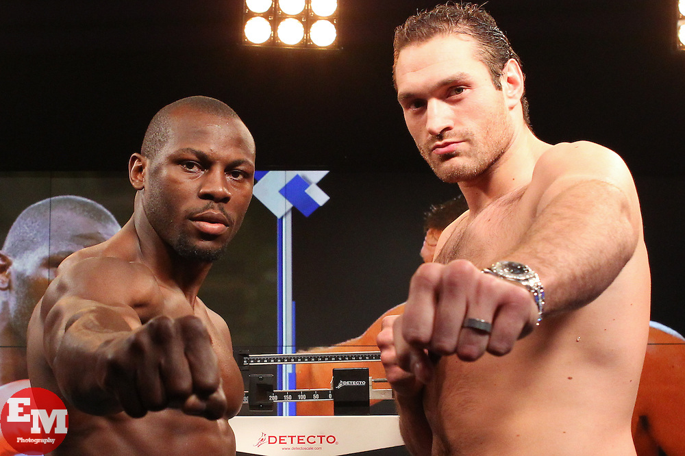 """Apr 19, 2013; New York, NY, USA; Heavyweights Steve Cunningham (left) and Tyson Fury (right) pose after weighing in for their fight on the set of the NBC Sports television show """"The Crossover""""."""