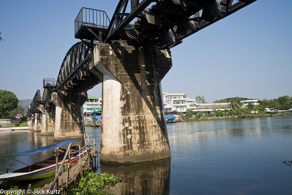 """20 FEBRUARY 2008 -- KANCHANABURI, THAILAND: Tourists on the """"Bridge over the River Kwai"""" in Kanchanaburi, Thailand. The infamous bridge and the """"Death Railway"""" that connected Thailand and Burma were built by Japanese military forces using prisoner of war and slave labor during World War II. More than 200,000 POWs and laborers were used to build the railway, about half of them died during the construction.  Photo by Jack Kurtz"""