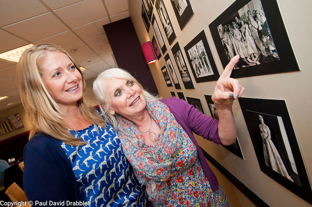 Susie Corbishley (left) and Cheryl Weston look at Royal Photographer Ian Pelham-Turners collection of previously unseen royal photographs in the Debenhams restaurant Harrogate on Thursday Afternoon..7 June 2012.Image © Paul David Drabble