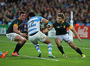 Argentina's Jeronimo De La Fuente trying to evade two South African tacklers during the Rugby World Cup Bronze Final match between South Africa and Argentina at the Queen Elizabeth II Olympic Park, London, United Kingdom on 30 October 2015. Photo by Matthew Redman.