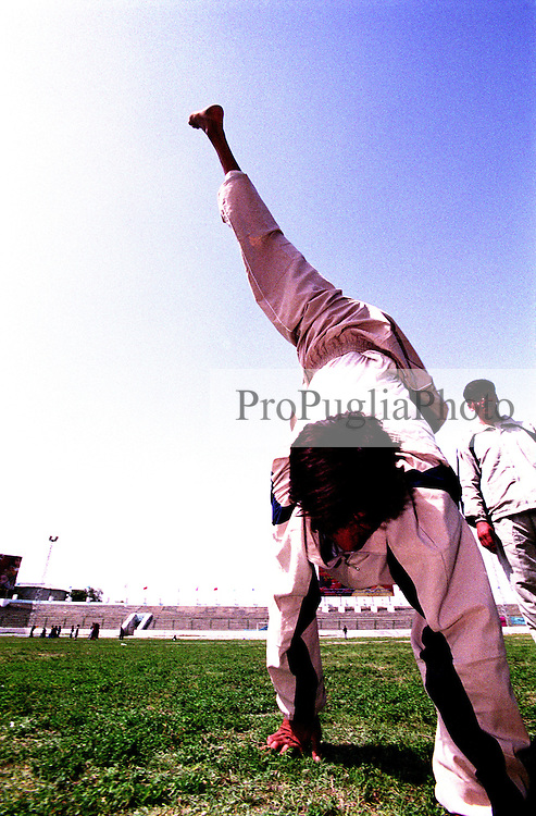 A physically handicapped athlete walking on his hands during  the Special Olympics Games for Disables at  Ghazi stadium, Kabul.