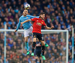 MANCHESTER, ENGLAND - Saturday, April 7, 2018: Manchester City's David Silva and Manchester United's Ander Herrera during the FA Premier League match between Manchester City FC and Manchester United FC at the City of Manchester Stadium. (Pic by David Rawcliffe/Propaganda)