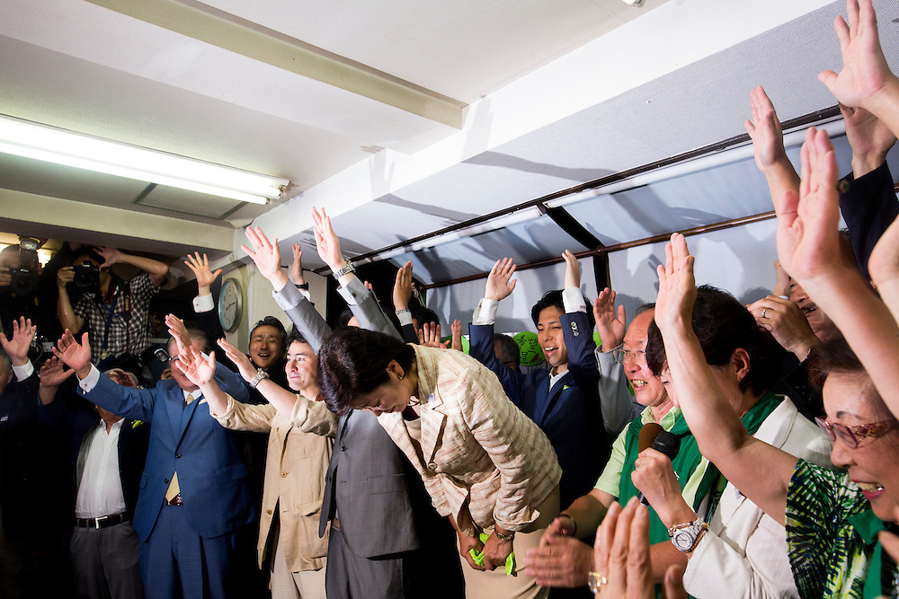 TOKYO, JAPAN - JULY 31 : Yuriko Koike, newly elected governor of Tokyo, center, bow to thank people after she speaks in a news conference after winning the Tokyo gubernatorial election at her office in Tokyo, Japan, on Sunday, July 31, 2016. Yuriko Koike a Liberal Democratic Party lawmaker and former defense minister is the first women to be elected as a Governor of Tokyo. (Photo: Richard Atrero de Guzman/NURPhoto)