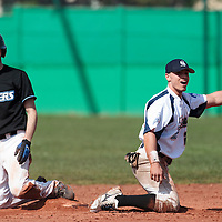 18 April 2010: Yann Dal Zotto of Savigny reacts after he fails to tag Matthieu Brelle Andrade as he slides back to second base during game 1/week 2 of the French Elite season won 8-1 by Savigny (Lions) over Senart (Templiers), at Parc municipal des sports Jean Moulin in Savigny-sur-Orge, France.