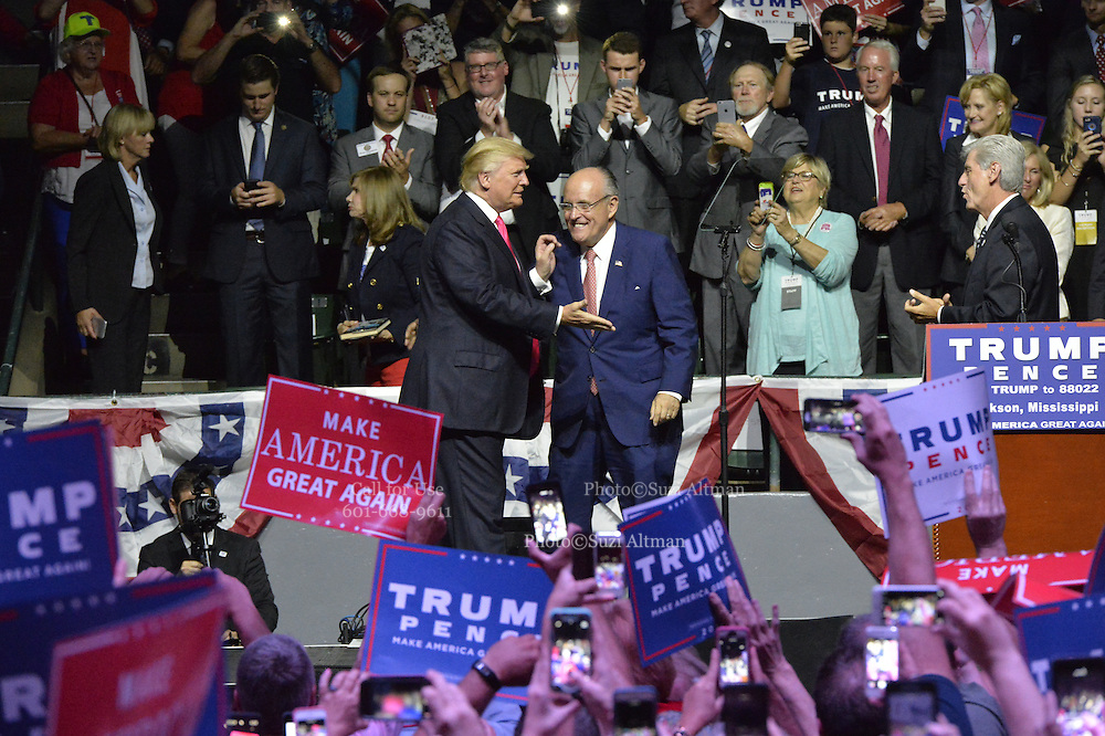 "8/24/16 Jackson,MS. Former New York City Mayor Rudy Giuliani, walks out with Republican Presidential candidate Donald J Trump at a rally in Jackson Mississippi. Trump spoke to a full house of mostly white supporters and called Hillary Clinton a ""bigot"" during his speech. While in Jackson Trump also made time to squeezed in a very private $1,000 dollar  per person fundraiser. It was so private you did not get the address for the location until the campaign received your donation. Photo © Suzi Altman"