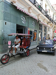 Old Havana, Cuba. Havana vieja, street. Old Soviet car Ziguli, Lada. Pedal taxi.