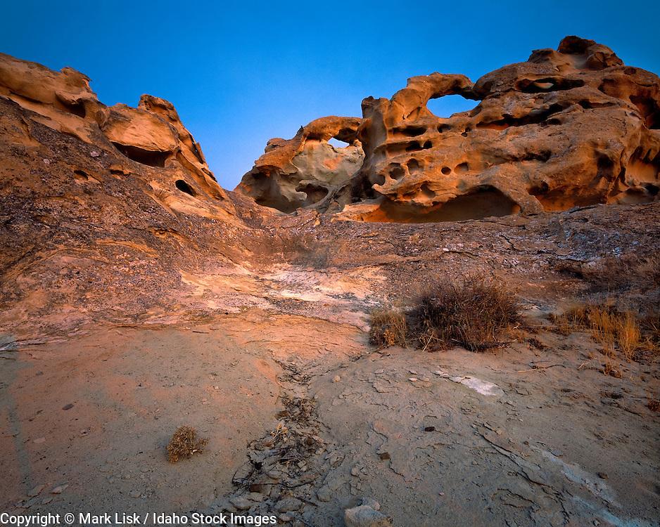 Fragile sandstone cliffs reflect the sunrise, Owyhee, Canyonlands,  Desert.