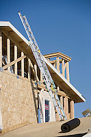 Ladder on wooden house construction