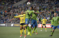 March 1, 2018 - Seattle, Washington, U.S - Soccer 2018: Seattle's TONY ALFARO (15) and NOUHOU (5) defend against a corner kick as Santa Tecla FC visits the Seattle Sounders for a CONCACAF match at Century Link Field in Seattle, WA. (Credit Image: © Jeff Halstead via ZUMA Wire)