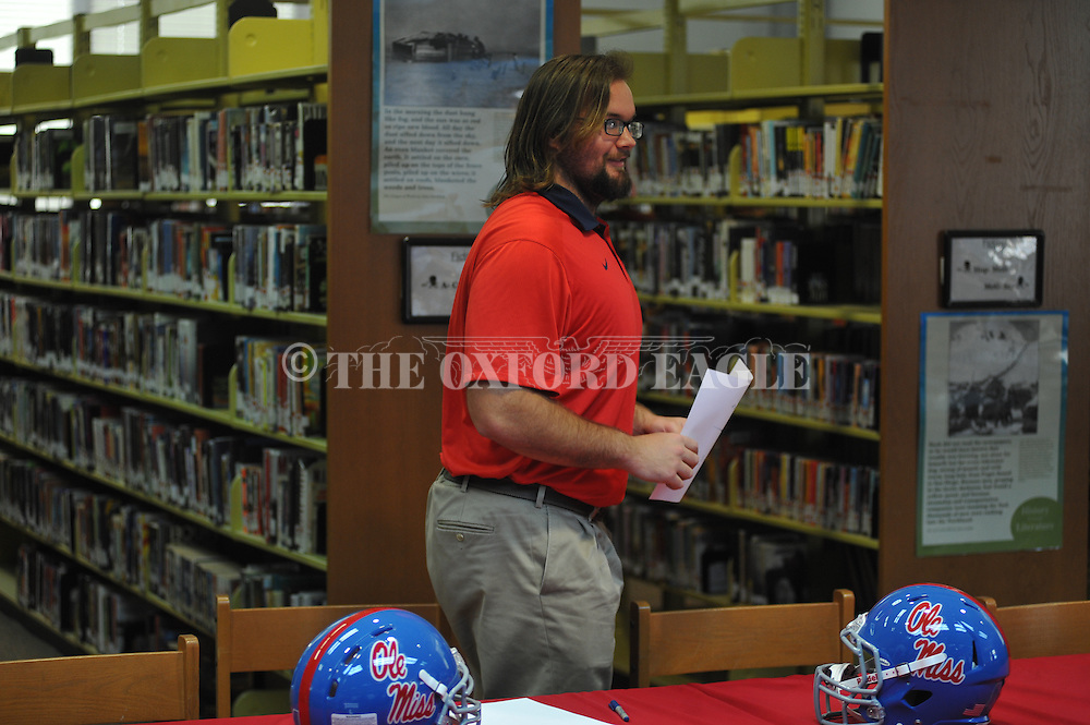 Lafayette High's Eli Johnson attends a National Signing Day event at Lafayette High School in Oxford, Miss. on Wednesday, February 3, 2016.