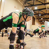 Foxy Force #5 stretching before Columbus, OH - Ohio Roller Girls, Gang Green starts to play. ..Pittsburgh, PA, Steel Hurtin' VS. the Ohio Roller Girls All Stars..Pittsburg PA Steel Beamers VS. Ohio Roller Girls Gang Green ..6 April 2013: at Louche Building - Ohio Expo Center in Columbus, Ohio. Dorn Byg/Byg Day LLC