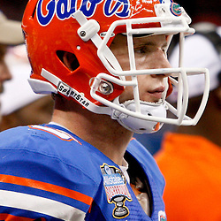 Jan 2, 2013; New Orleans, LA, USA; Florida Gators quarterback Jeff Driskel (6) looks on from the bench during the fourth quarter of the Sugar Bowl against the Louisville Cardinals at the Mercedes-Benz Superdome. Louisville defeated Florida 33-23. Mandatory Credit: Derick E. Hingle-USA TODAY Sports