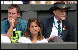 Image ©Licensed to i-Images Picture Agency. 02/07/2014. London, United Kingdom. Andy Murray's The women in Murray's life: Kim Sears chatted to her boyfriend's new coach, Amelie Mauresmo, watches  Murray loses the Men's  Quarter Finals on centre court in the Royal box at  Wimbledon. Picture by Andrew Parsons / i-Images