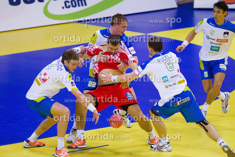 Zeljko Musa of Croatia between David Miklavcic of Slovenia, Matej Gaber of Slovenia, Peter Pucelj of Slovenia and Jure Dobelsek of Slovenia during handball match between Slovenia and Croatia in  2nd Round of Preliminary Round of 10th EHF European Handball Championship Serbia 2012, on January 18, 2012 in Millennium Center, Vrsac, Serbia. Croatia defeated Slovenia 31-29. (Photo By Vid Ponikvar / Sportida.com)