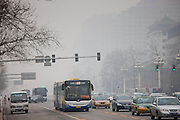 Coach and traffic on Beijing main street, Chang An Avenue, China
