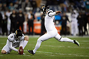 Jacksonville Jaguars rookie punter Logan Cooke (9) holds while Jacksonville Jaguars kicker Josh Lambo (4) attempts a kick during the week 14 regular season NFL football game against the Tennessee Titans on Thursday, Dec. 6, 2018 in Nashville, Tenn. The Titans won the game 30-9. (©Paul Anthony Spinelli)