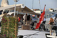 Friends get together aboard luxury yacht docked at superyacht marina in Port America's Cup; Valencia, Spain.