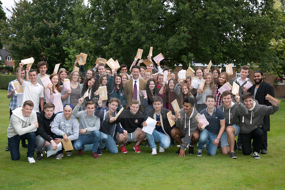 © Licensed to London News Pictures. 14/08/2014. Solihull, West Midlands, UK. A level results announced at Solihull School earlier today. Students celebrating their results with Headmaster David Lloyd, centre. Photo credit : Dave Warren/LNP