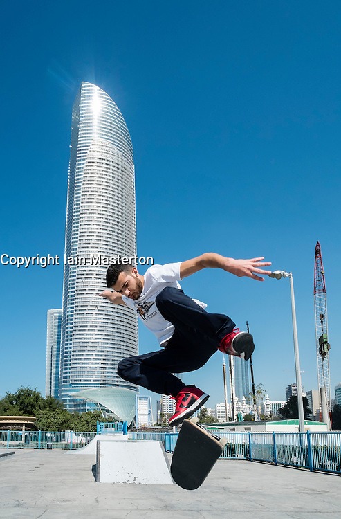Skateboarder in skatepark on Corniche in Abu Dhabi United Arab emirates