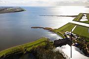 Nederland, Friesland, Gemeente Lemsterland, 16-04-2012; Lemmer, ir. D.F. Woudagemaal. In de achtergrond de Noordoostpolder (NOP). Het stoomgemaal staat op de Unesco Werelderfgoedlijst en is het grootste nog in bedrijf zijnde stoomgemaal ter wereld. Bij extreem hoge waterstand doet het gemaal nog dienst en helpt om de waterstand van het Friese boezem op peil te houden. Sinds 1967 is het gemaal oliegestookt. ..Lemmer, ir D.F. Woudagemaal. The steam pumping station features on the UNESCO World Heritage List and is the largest pumping station still in operation worldwide. At extreme high water, the station is still in service and helps to maintain the proper water level of the Friesian boezemwater. Since 1967, the pumping station is oil fired...luchtfoto (toeslag), aerial photo (additional fee required).foto/photo Siebe Swart