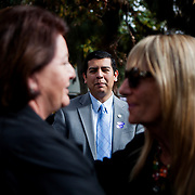 Mayoral candidate David Alvarez watches on as Assemblymember Toni Atkins greets former City Councilwoman Donna Frye.