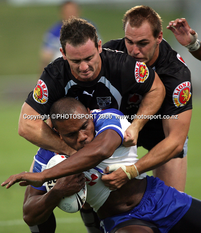 Bulldogs wing Namila Davui is tackled by Lance Hohaia and Simon Mannering at the pre season NRL match between the Warriors and Bulldogs at North Harbour Stadium, Auckland, New Zealand, on Saturday 3 March 2007. Photo: Andrew Cornaga/PHOTOSPORT