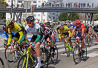 Semi-professional cycle racing, San Pedro de Alcantara, Marbella, Malaga, Province, Spain, March 2015. Spectators watch from the elevated pedestrian walkway along the new Bulevar aka The Boulevard. 201503140589<br /> <br /> Copyright Image from Victor Patterson, 54 Dorchester Park, Belfast, UK, BT9 6RJ<br /> <br /> t: +44 28 9066 1296<br /> m: +44 7802 353836<br /> vm +44 20 8816 7153<br /> <br /> e1: victorpatterson@me.com<br /> e2: victorpatterson@gmail.com<br /> <br /> www.victorpatterson.com<br /> <br /> IMPORTANT: Please see my Terms and Conditions of Use at www.victorpatterson.com