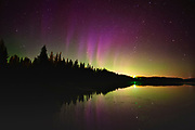 Norhern lights (Aurora borealis) reflected in Lac Sauvage <br />Chibougameau<br />Quebec<br />Canada