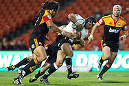 Sharks' Adrian Jacobs is tackled by Chiefs' Mike Delany. Super 15 rugby union match, Chiefs v Sharks at Waikato Stadium, Hamilton, New Zealand. Friday 18th March 2011. Photo: Anthony Au-Yeung / photosport.co.nz