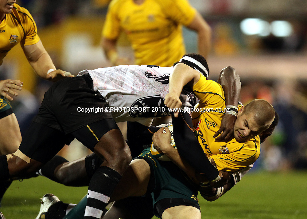 Drew Mitchell tackled by Dominiko Waqaniburotu<br /><br />International Test rugby union match, Australia v Fiji, Canberra, Australia. Saturday 5 June 2010. Photo: Paul Seiser/PHOTOSPORT