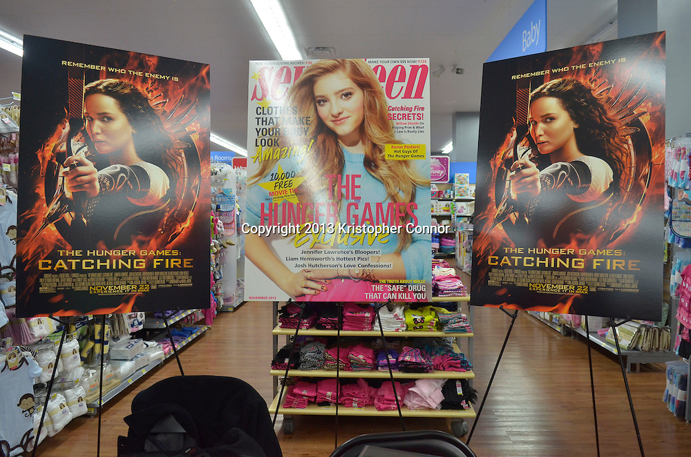 "Vienna, Va - NOVEMBER 13: Actress Willow Shields from the upcoming movie ""The Hunger Games: Catching Fire"" signs posters and issues of Seventeen Magazine at Walmart on November 13, 2013 in Vienna, Virginia. (Photo by Kris Connor/LionGate)"