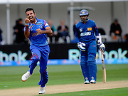 Dawlat Zadran of Afganistan celebates with team mates his wicket of Lahiru Thrimanna during the ICC Cricket World Cup match between Afghanistan and Sri Lanka at university oval in Dunedin, New Zealand. Photo: Richard Hood/photosport.co.nz