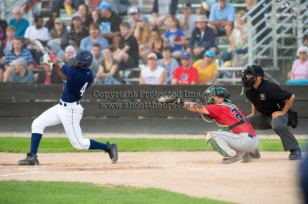 KELOWNA, BC - JULY 16: Richi Sede #4 of the Kelowna Falcons hits the ball against the the Wenatchee Applesox  at Elks Stadium on July 16, 2019 in Kelowna, Canada. (Photo by Marissa Baecker/Shoot the Breeze)