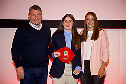 NEWPORT, WALES - Saturday, May 19, 2018: Esther Morgan is presented with her Under-16's cap by Osian Roberts (left) and Lauren Dykes (right) during the Football Association of Wales Under-16's Caps Presentation at the Celtic Manor Resort. (Pic by David Rawcliffe/Propaganda)