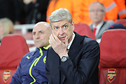 Arsene Wenger with hand on face during the Champions League round of 16, game 2 match between Arsenal and Bayern Munich at the Emirates Stadium, London, England on 7 March 2017. Photo by Matthew Redman.
