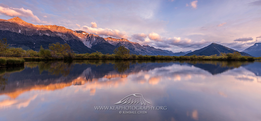 A panoramic of a beautiful sunrise over the Humboldt Mountains with the pyramid-shaped Mt Alfred to the right, in Glenorchy, New Zealand.