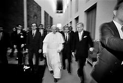 Pope John Paul II is  walking in the Prague Castle, Prague a few weeks after the  Velvet revolution in Czechoslovakia.