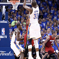 12 June 2012: Oklahoma City Thunder small forward Kevin Durant (35) takes a jumpshot over Miami Heat shooting guard Dwyane Wade (3) during the first quarter of Game 1 of the 2012 NBA Finals between the Heat and the Thunder, at the Chesapeake Energy Arena, Oklahoma City, Oklahoma, USA.