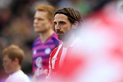 Joe Allen of Stoke City walks past flag bearers - Mandatory by-line: Robbie Stephenson/JMP - 15/10/2016 - FOOTBALL - Bet365 Stadium - Stoke-on-Trent, England - Stoke City v Sunderland - Premier League
