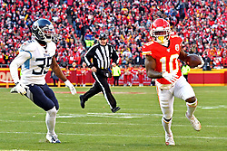 Jan 19, 2020; Kansas City, Missouri, USA; Kansas City Chiefs wide receiver Tyreek Hill (10) runs for a touchdown during the second quarter against Tennessee Titans defensive back Tramaine Brock (35) in the AFC Championship Game at Arrowhead Stadium. Mandatory Credit: Denny Medley-USA TODAY Sports