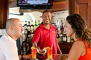 Couple at the  bar - Oyster Bay Beach Resort