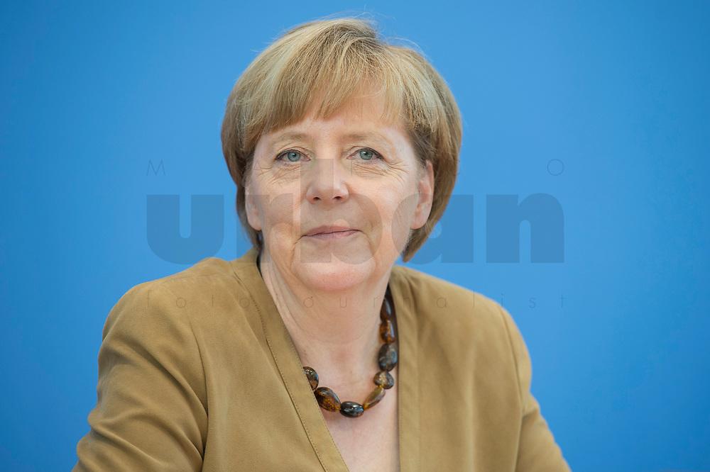 18 JUL 2014, BERLIN/GERMANY:<br /> Angela Merkel, CDU, Bundeskanzlerin, waehrend der sog. Sommer-Pressekonferenz der Bundeskanzlerin zu aktuellen Themen der Innen- und Außenpolitik, Bundespressekonferenz<br /> IMAGE: 20140718-01-028<br /> KEYWORDS: freundlich