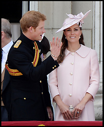 : Prince Harry with the Duchess of Cambridge as they watch the fly past on the Balcony of Buckingham Palace during Trooping The Colour, London, United Kingdom,<br /> Saturday, 15th June 2013<br /> Picture by Andrew Parsons / i-Images