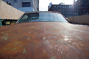 an old rusty big American car