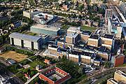 Nederland, Zuid-Holland, Leiden, 15-07-2012; Leids Universitair Medisch Centrum LUMC (rechts) met daar achter het station. Links Gebouw 2 van het LUMC, Poortgebouw centraal op het terrein.  Pesthuis in de voorgrond.  .University hospital (LUMC)  of the city of Leiden, square building is the Plague House (Pesthuis). Railway station (r).luchtfoto (toeslag), aerial photo (additional fee required).foto/photo Siebe Swart