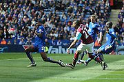 Leicester City defender Wes Morgan (5)  tries to stop West Ham United midfielder Dimitri Payet (27) shot during the Barclays Premier League match between Leicester City and West Ham United at the King Power Stadium, Leicester, England on 17 April 2016. Photo by Simon Davies.